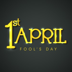 happy-fools-day-funky-concept-with-golden-text-on-grey-background_7JbwAG